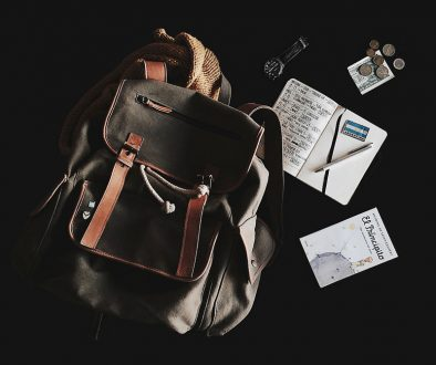 Backpack with passport and money for travel preparation