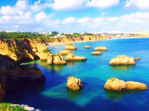 Blue ocean with rocks and beaches in Algarve Portugal