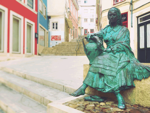 Streets with statue of Coimbra in old town