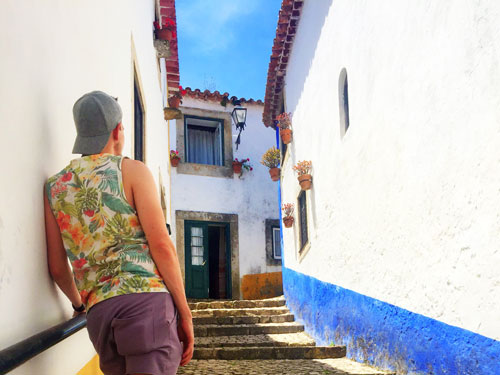 Walk through picturesque streets of Obidos with white houses