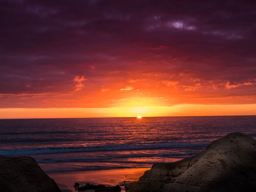 Beautiful red and orange sunset in the Algarve Portugal